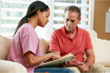 woman discussing to a senior man