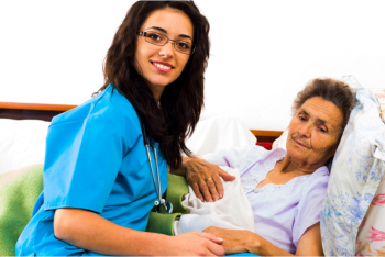elderly woman lying and her caregiver