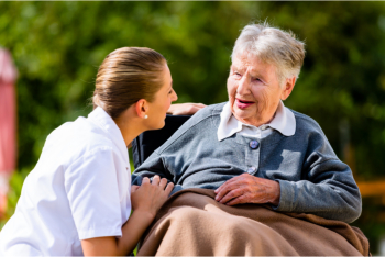 elderly woman with her caregiver